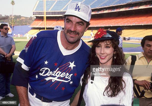 Actor Tom Selleck and wife Jillie Mack attend the 34th Annual Hollywood Stars Night Celebrity Baseball Game on August 17 1991 at Dodger Stadium in...