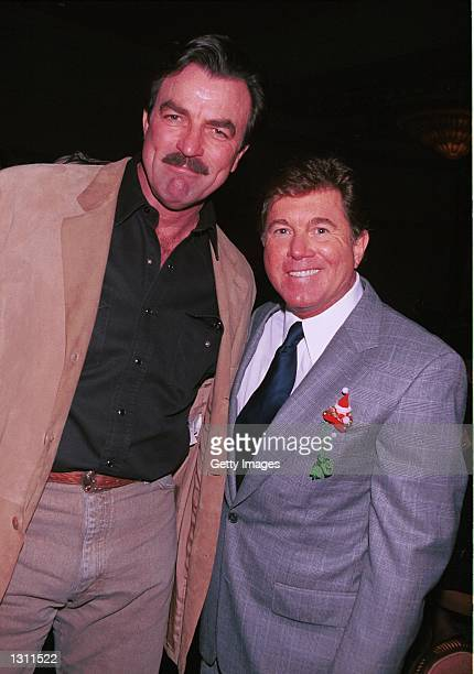 Actor Tom Selleck poses with his Magnum PI television show costar Larry Manetti at the Holly Jolly Jubilee for the TV and Motion Pictures Mothers...