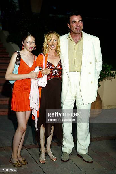 S actor Tom Selleck poses with his wife and his daughter as he arrives to attend a dinner at the Palm Beach during the 44th MonteCarlo Television...