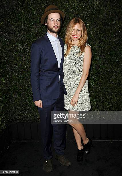 Actor Tom Sturridge and actress Sienna Miller attend the Chanel and Charles Finch preOscar dinner at Madeo Restaurant on March 1 2014 in Los Angeles...