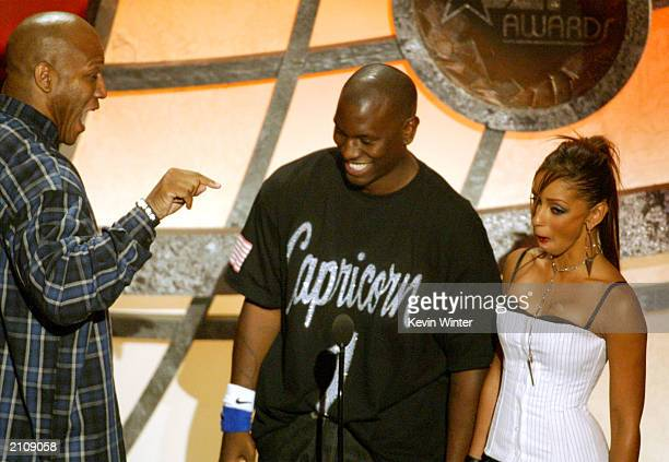 Actor Tom 'Tiny' Lister Jr speaks to singers Tyrese and Mya on stage as they present the award for 'Best Actress' during the 3rd Annual BET Awards...