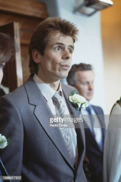 Actor Tom Watt pictured on a church set during filming for the BBC soap opera 'EastEnders' 1986