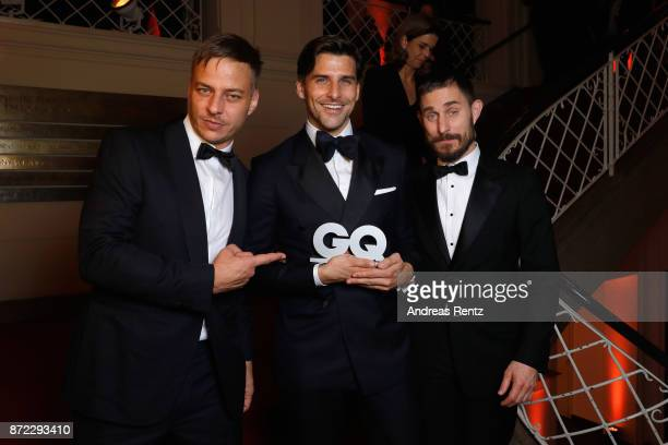 Actor Tom Wlaschiha model and award winner Influencer of the Year Johannes Huebl and actor Clemens Schick attend the GQ Men of the year Award 2017...