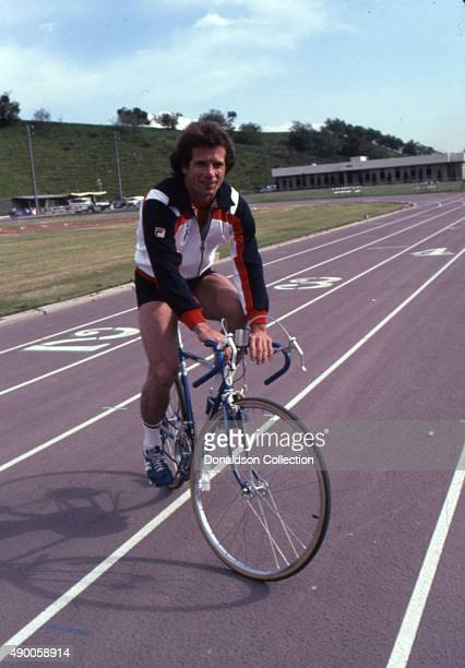 Actor Tom Wopat rides a bicycle wearing a Fila running jacket and New Balance sneakers in 1980 in Los Angeles California