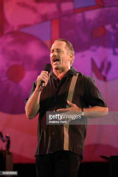 Actor Tom Wopat sings during the dress rehearsal of 'Broadway Under The Stars' at Bryant Park June 13 2004 in New York City