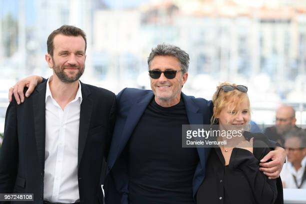 "Actor Tomasz, director Pawel Pawlikowski and actress Joanna Kulig attend the photocall for ""Cold War "" during the 71st annual Cannes Film Festival at..."