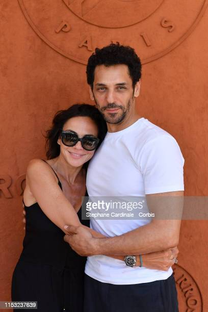 Actor Tomer Sisley and his companion Sandra Zeitoun attend the 2019 French Tennis Open Day Eight at Roland Garros on June 02 2019 in Paris France
