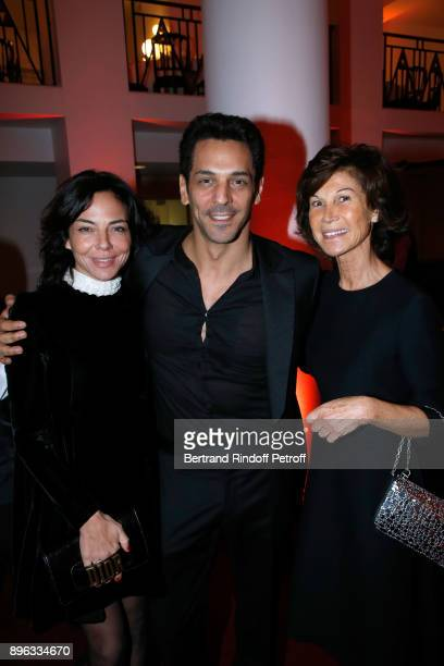 Actor Tomer Sisley standing between his wife Sandra and Sylvie Rousseau attend the Gala evening of the PasteurWeizmann Council in Tribute to Simone...
