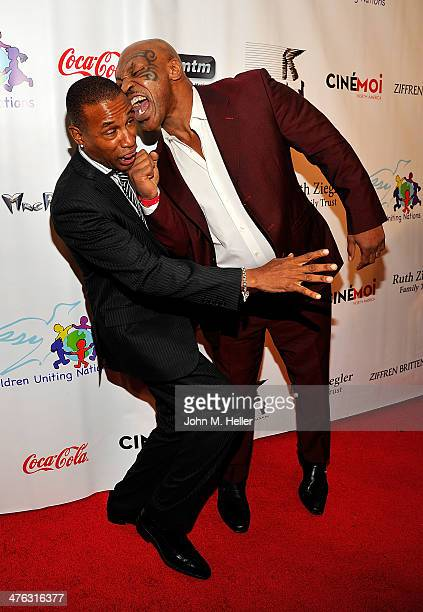 Actor Tommy Davidson and former heavyweight boxing champion of the world Mike Tyson clown around at the 15th Annual Academy Awards Viewing Partying...
