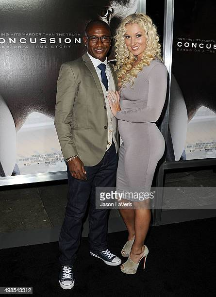 Actor Tommy Davidson and wife Amanda Davidson attend a screening of 'Concussion' at Regency Village Theatre on November 23 2015 in Westwood California