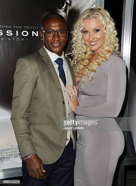Actor Tommy Davidson and wife Amanda Davidson attend a screening of Concussion at Regency Village Theatre on November 23 2015 in Westwood California