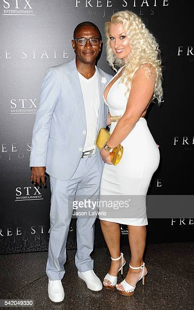 Actor Tommy Davidson and wife Amanda Moore attend the premiere of 'Free State of Jones' at DGA Theater on June 21 2016 in Los Angeles California