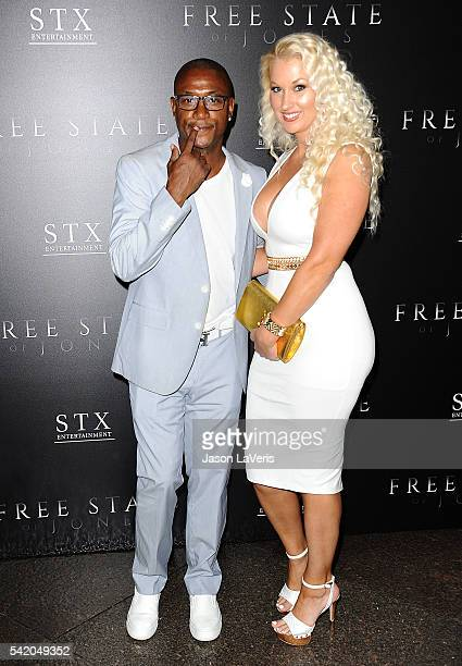 Actor Tommy Davidson and wife Amanda Moore attend the premiere of Free State of Jones at DGA Theater on June 21 2016 in Los Angeles California