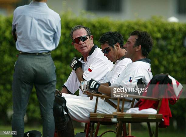 Actor Tommy Lee Jones chats between chukkers at the International Polo Club Palm Beach on February 6 2004 in Wellington Florida