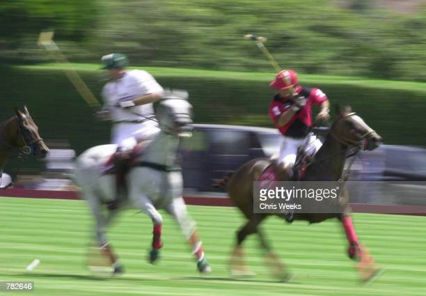 Actor Tommy Lee Jones hits a back shot as he competes with his San Saba polo team at the Santa Barbara Polo Racquet Club July 30 2000 in Santa...