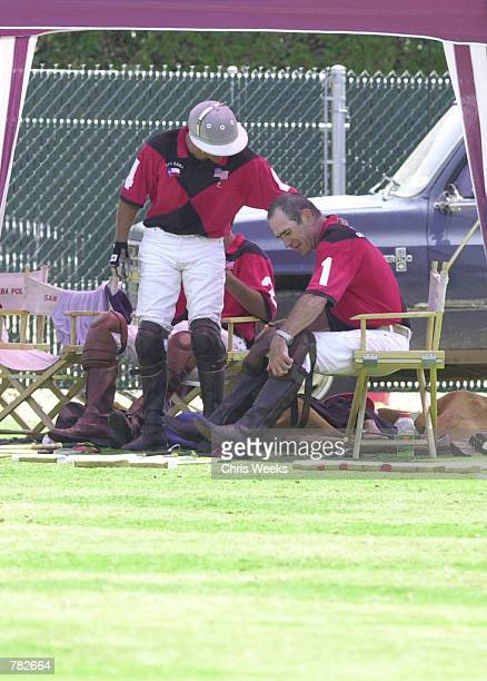 Actor Tommy Lee Jones is congratulated by his San Saba polo teammate Guillermo Caset after their victory at the Santa Barbara Polo Racquet Club July...