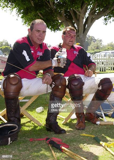 Actor Tommy Lee Jones left and his San Saba polo teammate Luis Echezarreta share a drink between chukkers July 16 2000 at the Santa Barbara Polo Club...