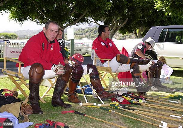 Actor Tommy Lee Jones left rests with his polo team San Saba July 16 2000 at the Santa Barbara Polo Club in Santa Barbara CA where they competed for...