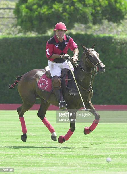 Actor Tommy Lee Jones prepares to strike a ball as he competes with his San Saba polo team at the Santa Barbara Polo Racquet Club July 30 2000 in...