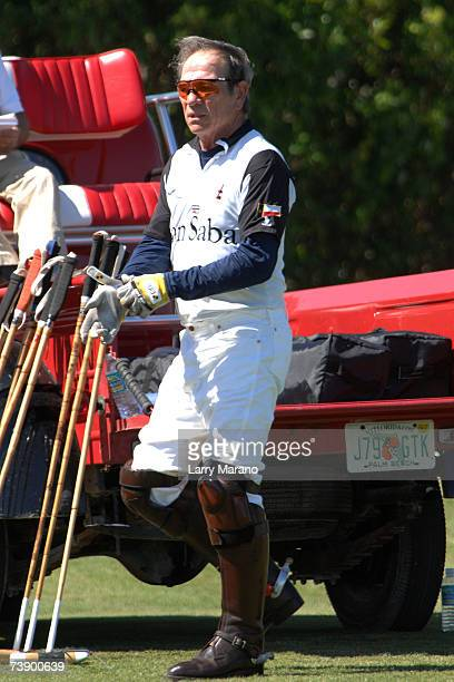 Actor Tommy Lee Jones puts on a glove during a competition with his Polo Team San Saba in the Stanford US Open at International Polo Club Palm Beach...