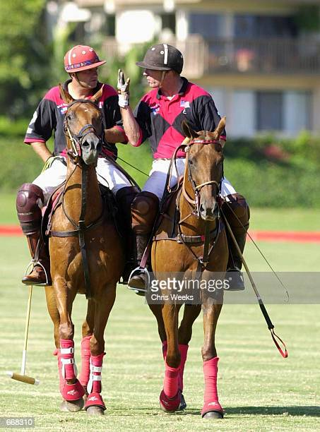 Actor Tommy Lee Jones right discusses a three goal deficit with his San Saba polo teammate Luis Echezarreta July 16 2000 at the Santa Barbara Polo...