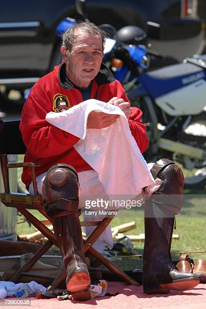 Actor Tommy Lee Jones uses a towel during a competition with his Polo Team San Saba in the Stanford US Open at International Polo Club Palm Beach...