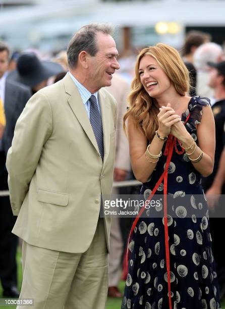 Actor Tommy LeeJones and Cat Deeley share a laugh as they attend the Cartier International Polo Day on July 25 2010 in Egham England