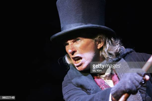 Actor Tommy Steele poses at a photocall to promote his role as Ebenezer Scrooge in the new stage version of Scrooge at the London Palladium on...