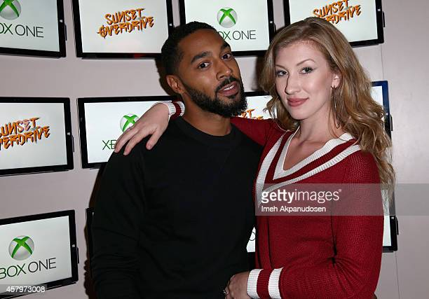 Actor Tone Bell and Sarah Schubert attend the Sunset Overdrive Launch at The Microsoft Lounge on October 27 2014 in Venice California