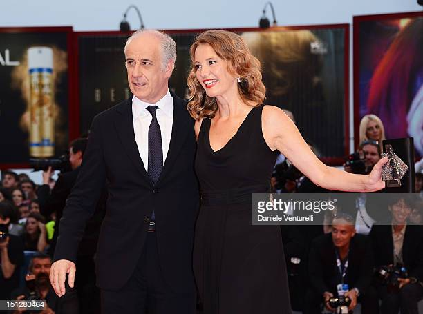 """Actor Toni Servillo and his wife Manuela Lamanna attend """"Bella Addormentata"""" Premiere during The 69th Venice Film Festival at the Palazzo del Cinema..."""