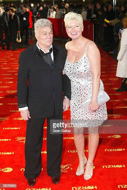 Actor Tony Curtis and his wife Jill Ann Curtis attend the Goldene Kamera Film Awards on February 4, 2004 in Berlin, Germany.