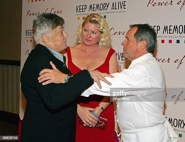 Actor Tony Curtis and his wife Jill Curtis greet chef Wolfgang Puck as they arrive at the Keep Memory Alive Foundation's 10th annual gala to benefit...