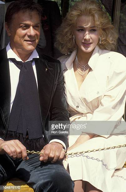 Actor Tony Curtis and wife Andrea Savio attend Universal Studios Anniversary Celebration on May 2 1984 at Universal Studios in Universal City...