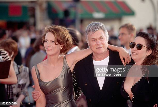 Actor Tony Curtis attends an awards ceremony in Hollywood with his daughter Jamie Lee Curtis and his wife Lisa Deutsch