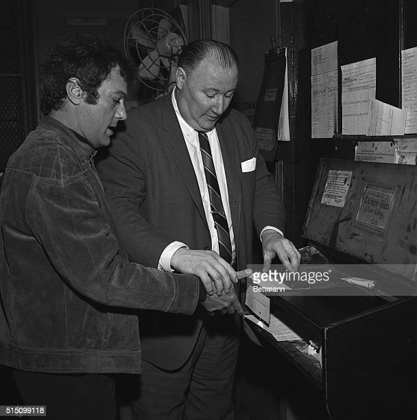 Actor Tony Curtis has his fingerprints taken for real by a real detective Robert W Cahill in a real police station in New York January 19th Tony...