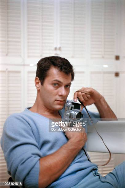 Actor Tony Curtis poses for a portrait at home on August 4 1956 in Los Angeles California