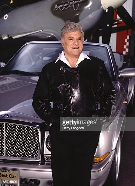 Actor Tony Curtis poses for a portrait in 2003 at the Air Museum in Santa Monica California
