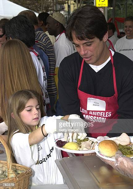 "Actor Tony Danza and daughter Emily help to serve free dinners to the homeless at the Los Angeles Mission during ""The Great Thanksgiving Banquet""..."