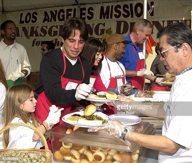 Actor Tony Danza and daughter Emily prepare traditional Thanksgiving Day dinners to be served by volunteers to over 5,000 homeless people at the Los...