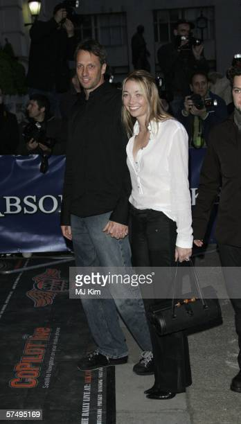 Actor Tony Hawk and guest arrive at Gumball 3000 film premiere 2006 rally launch party at Savoy Place on April 29 2006 in London England