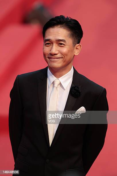 Actor Tony Leung arrives at the red carpet during the opening ceremony for the 15th Shanghai International Film Festival at Shanghai Grand Theatre on...