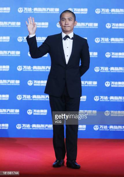 Actor Tony Leung ChiuWai arrives at the red carpet during the opening night of the Qingdao Oriental Movie Metropolis at Qingdao Beer City on...