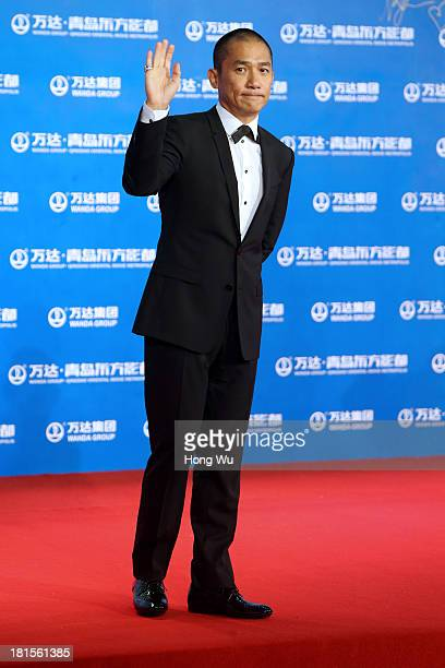 Actor Tony Leung ChiuWai attends the red carpet show for the Qingdao Oriental Movie Metropolis on September 22 2013 in Qingdao China