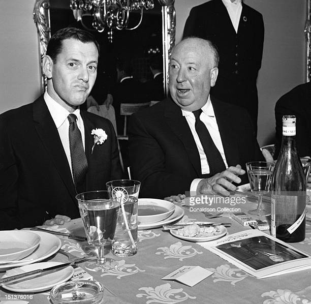 Actor Tony Randall and director Alfred Hitchcock pose for a portrait at a dinner for the Motion Picture Pioneers Association at the Playboy Club on...
