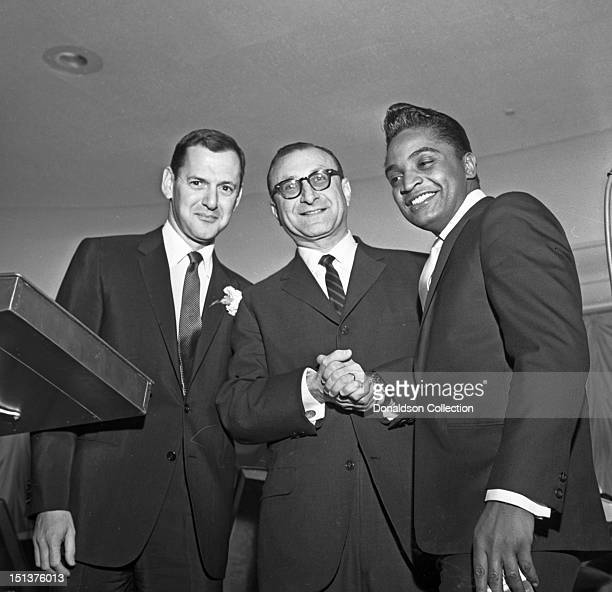Actor Tony Randall and rock and roll singer Jackie Wilson pose for a portrait with another man at a dinner for the Motion Picture Pioneers...