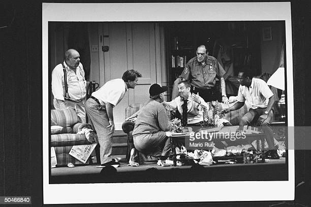 Actor Tony Randall as Felix Unger being consoled by actor Jack Klugman as Oscar Madison as actors Jack Weston Martin Sheen Abe Vigoda Cleavon Little...