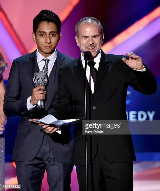 Actor Tony Revolori and producer Jeremy Dawson accept the Best Comedy award for 'The Grand Budapest Hotel' onstage during the 20th annual Critics'...