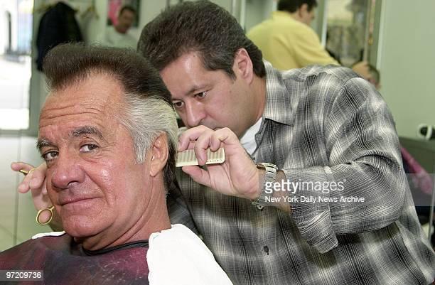 Actor Tony Sirico gets a trim from Saverio Carchidi in a Bay Ridge Brooklyn barbershop