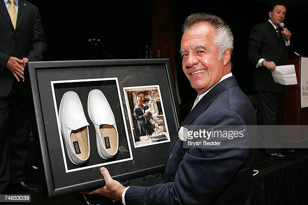 Actor Tony Sirico holds the shoes he wore on the television show 'The Sopranos' which are up for auction at the St Jude's Children's Research...