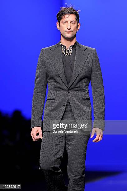 Actor Tony Ward walks the runway during the Roberto Cavalli Fashion Show as part of Milan Fashion Week Menswear A/W 2011 on January 15, 2011 in...